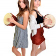 Two girls with drums - Stock Photo