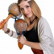Beautiful blonde with maracas - Foto Stock