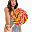 Nice girl looks on lolipop — Stock Photo #7991116