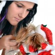 Pretty girl and dog in santa hat at Christmas — Stock Photo #8042044