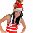 Pretty girl and dog in santa hat at Christmas — Stock Photo #8044067