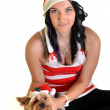 Pretty girl and dog in santa hat at Christmas — Stock Photo #8060629