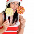 Santa Claus with a lollypop — Stock Photo