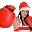 Santa hat christmas woman celebrating wearing boxing gloves. — Stock Photo #8060839
