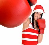 Santa hat christmas woman celebrating wearing boxing gloves. — Stock Photo