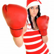 Santa hat christmas woman celebrating wearing boxing gloves. — Stock Photo #8073296