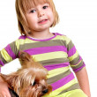 Beautiful little girl with Yorkie pup — Stock Photo