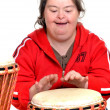 Stock Photo: Down syndrome with djembe
