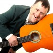 Down syndrome man with guitar — Stock Photo