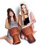Two girls with bongo — Stock Photo