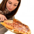 Royalty-Free Stock Photo: Girl eating pizza isolated on white