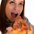 Girl eating pizza isolated on white — Stock Photo #8147442