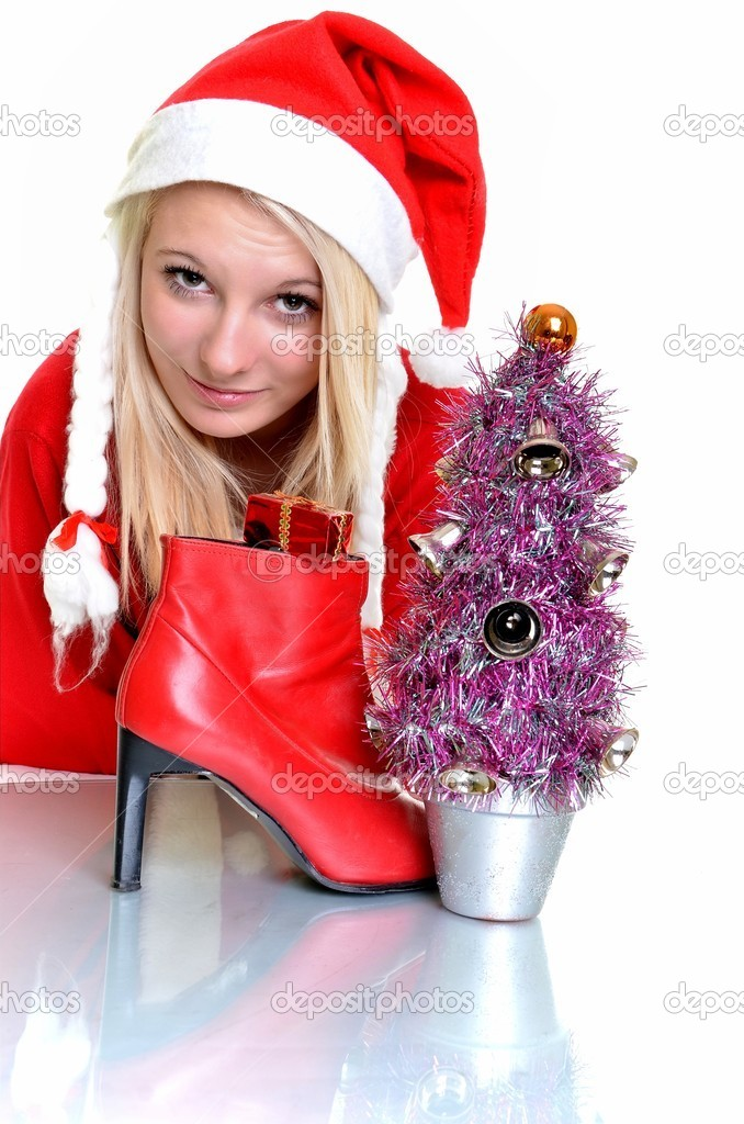 Beautiful and sexy blonde woman wearing santa clause costume on white  — Stock Photo #8166393