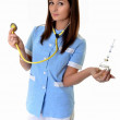 Beautiful young doctor with injection — Stock Photo #8264340