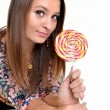 Sexy young brunette woman with a lollipop — Zdjęcie stockowe