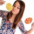 Sexy young brunette woman with a lollipop — Stok fotoğraf