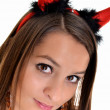Pretty young girl is wearing a sexy devil costume with a trident, isolated — Stock Photo