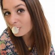 Beautiful girl making a bubble from chewing gum — Stock Photo