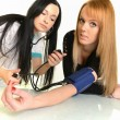 Stock Photo: Female doctor and patient islolated on white