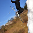 Skier at jump inhigh mountains at sunny day. — Stock Photo #8453515