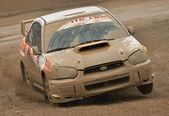 Rally car passing on a mud track — Stock Photo