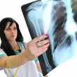 A female doctor is checking x-ray - isolated on white background  — Stock Photo