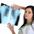 A female doctor is checking x-ray - isolated on white background - Стоковая фотография