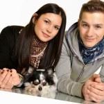 Couple with dog — Stock Photo #8653356