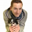 Funny portrait of a young man holding a cute chihuahua dog — Stock Photo
