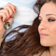 Portrait of young beautiful woman with jewerly in bed - Stock Photo