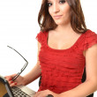 Young business woman on a laptop - isolated on white — Stock Photo