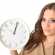 Young beautiful woman with the clock. — Stock Photo
