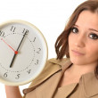 Young beautiful woman with the clock. — Stock Photo #8744156