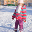 Baby in winter street — Stock Photo