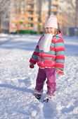 Baby in winter street — Stock Photo