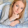 Stock Photo: Young beautiful girl in a bed