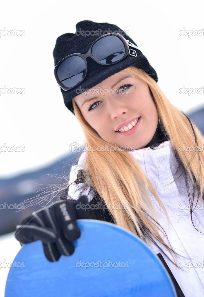 Woman holding snowboard with mountains in background  — Stock Photo #8851611