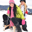 Young women with sled - Lizenzfreies Foto