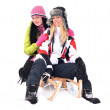 Girls sledding — Stockfoto