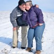 Down syndrome couple sledding — Stockfoto