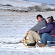 Down syndrome couple sledding — Stock Photo #8889488