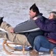 Down syndrome couple sledding — Stock Photo