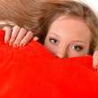 Stock Photo: Attractive young woman hugging heart-shaped pillow. All on white background
