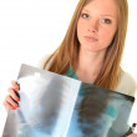 Female doctor examining an x-ray — Stock Photo #8974500