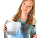 Female doctor examining an x-ray — Stock Photo #8974504