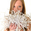 Woman with shredded paper — Stock Photo