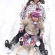 Mother and daughter sledging, nice winter scene — Stock Photo