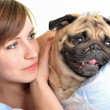 Woman with pug in bed — Stock Photo