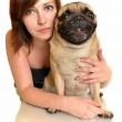 Cute brunette hugging a pug — Stock Photo