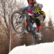 Mountain biker riding a snowy trail in winter - Photo
